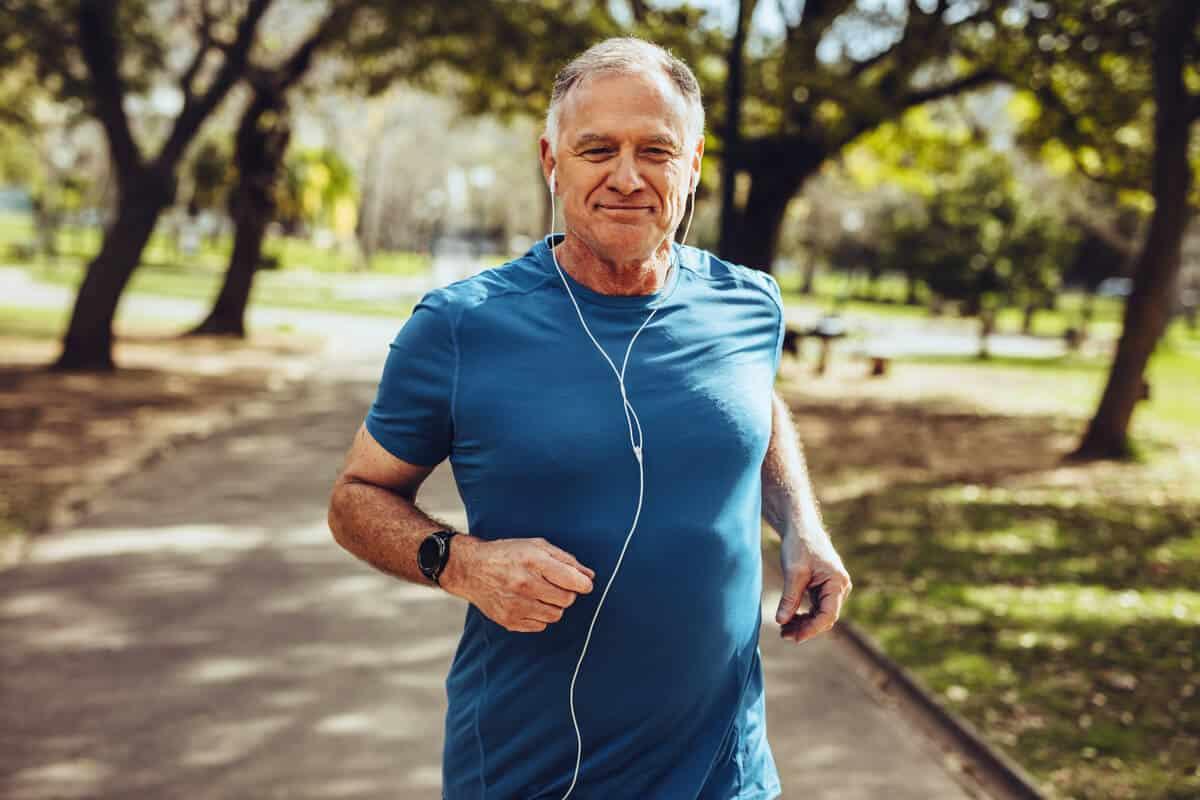 men running outdoors with headphones
