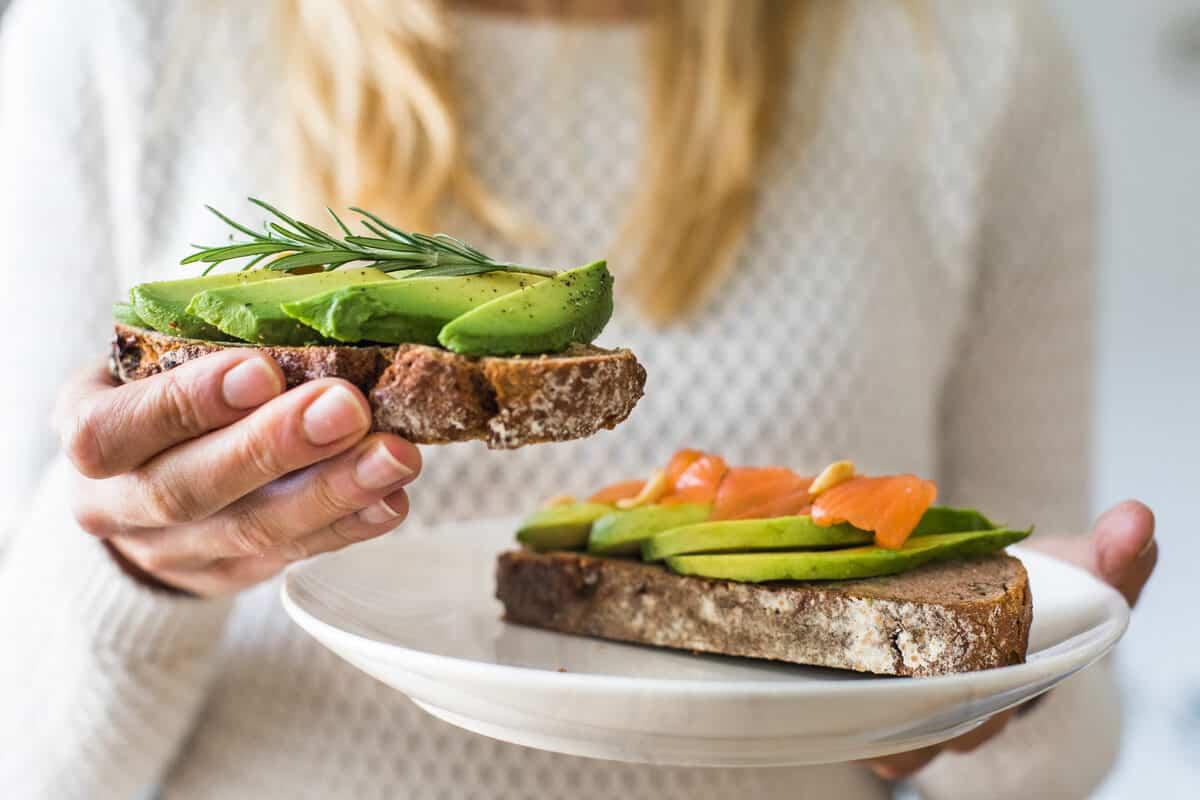 Woman holding avocado toast