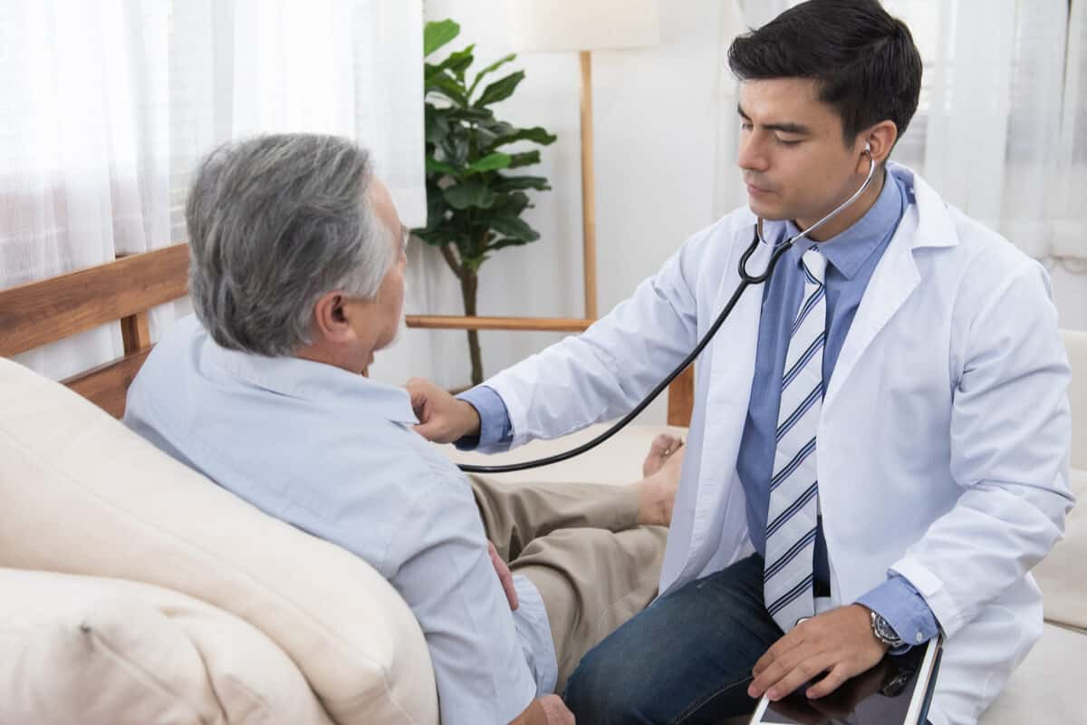 Practitioner consulting with a patient