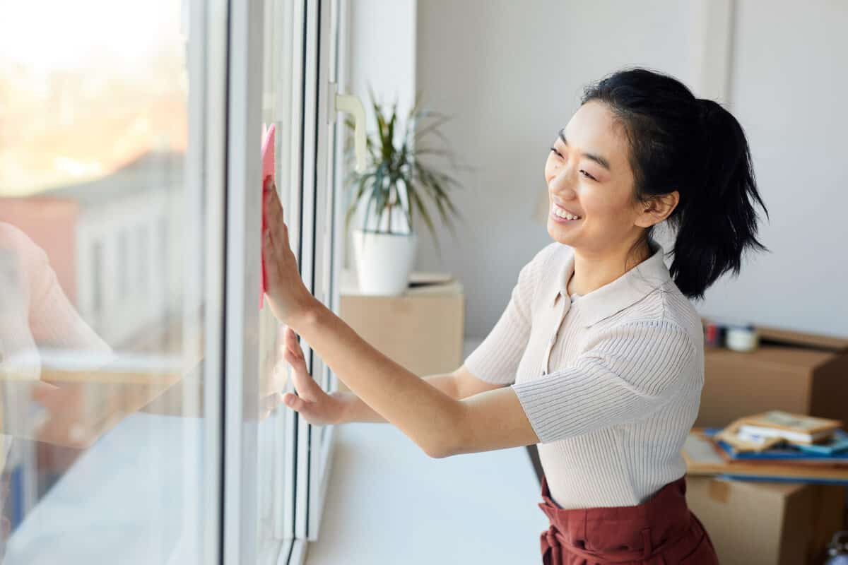 Mold exposure woman cleaning window